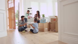 Hispanic Family Moving Into New Home Shot On R3D