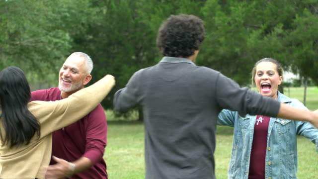 hispanic family reunion, teenage son and adult daughter - open arms stock videos & royalty-free footage