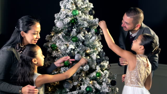 hispanic family with two girls decorating christmas tree - 6 7 years stock videos & royalty-free footage