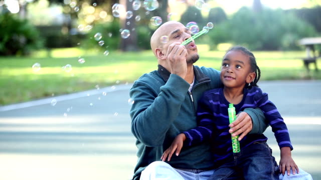 hispanic father and mixed race son, with bubble wand - single parent family stock videos & royalty-free footage