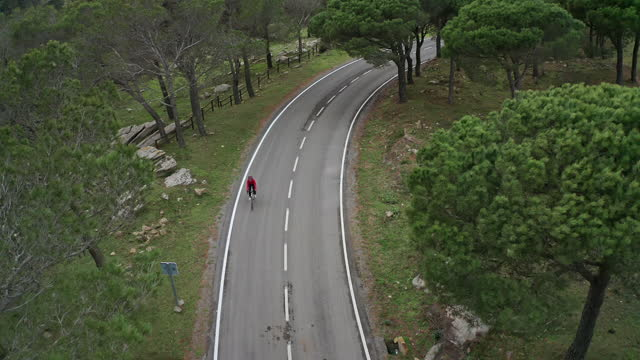 "hispanic female athlete riding bicycle on cap de creus road - xavierarnau or ""xavier arnau serrat"" stock videos & royalty-free footage"
