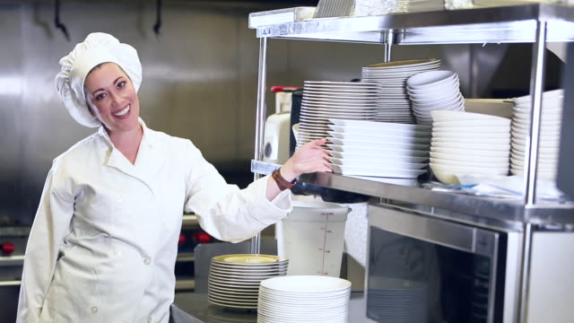 hispanic female chef in restaurant kitchen - stack of plates stock videos & royalty-free footage