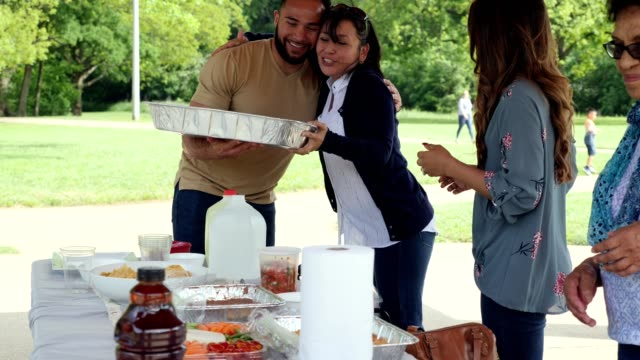 hispanic female family members prepare food for family reunion - picnic stock videos & royalty-free footage