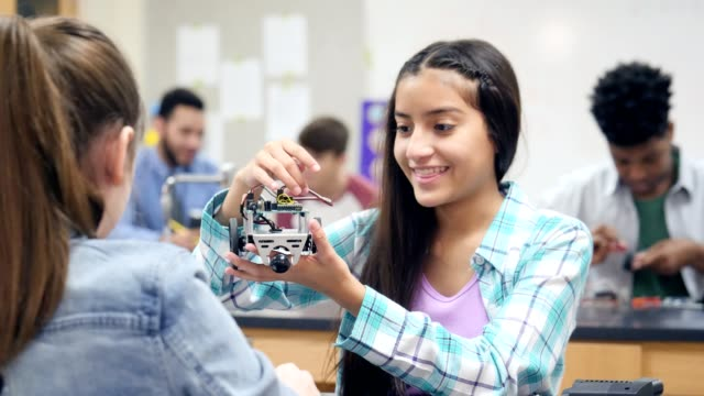 hispanic female high school student shows off robotics project - organized group stock videos & royalty-free footage