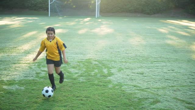 hispanic girl showing off soccer skills, ball control - soccer uniform stock videos & royalty-free footage