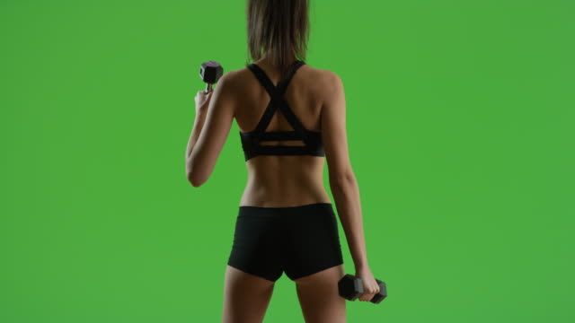 a hispanic girl works out on green screen - chroma key studio stock videos & royalty-free footage