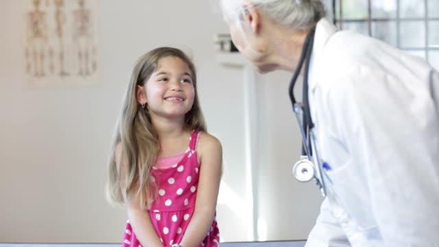 Hispanic Girl's Pediatrician Visit