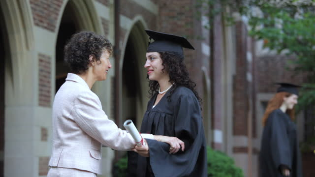 stockvideo's en b-roll-footage met td hispanic graduate with diploma with mother  richmond, virginia, usa - diploma