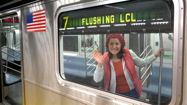 vídeos de stock e filmes b-roll de hispanic latin american woman looks through the glass window of a new york city subway car / hudson yards 34th street subway station train manhattan... - só mulheres de idade mediana