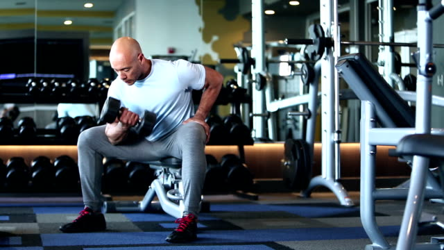 hispanic man body building, lifting dumbbell - concentration stock videos & royalty-free footage