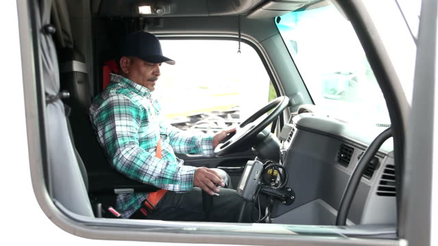 hispanic man climbing into cab of semi-truck - articulated lorry stock videos and b-roll footage