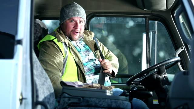 hispanic man driving truck, climbs into driver's seat - van vehicle stock videos & royalty-free footage