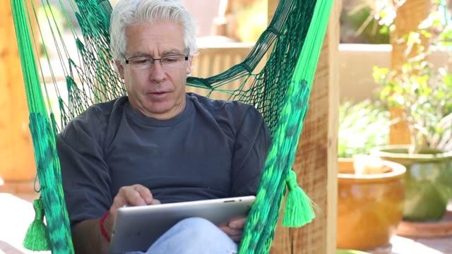 hispanic man in hammock - baby boomer stock videos & royalty-free footage
