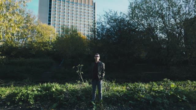 Hispanic man standing in a park