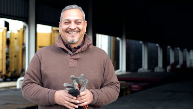 hispanic man working at train loading dock - manual worker stock videos & royalty-free footage