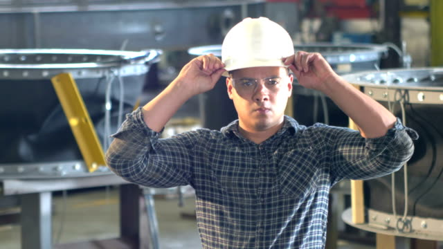 hispanic man working in metal fabrication plant, hardhat - safety glasses stock videos & royalty-free footage