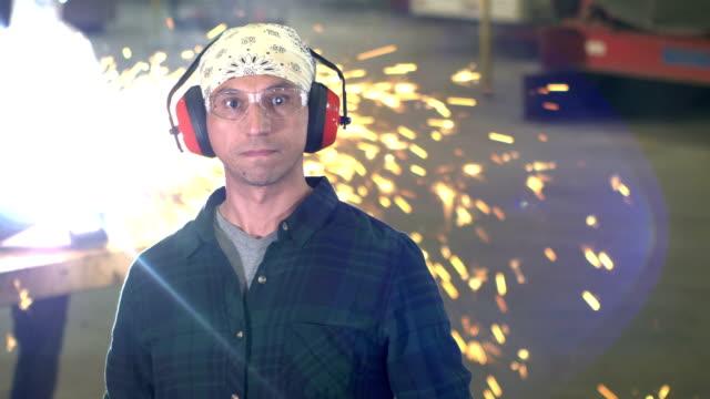 hispanic man working in metal fabrication shop, welder - construction worker stock videos & royalty-free footage