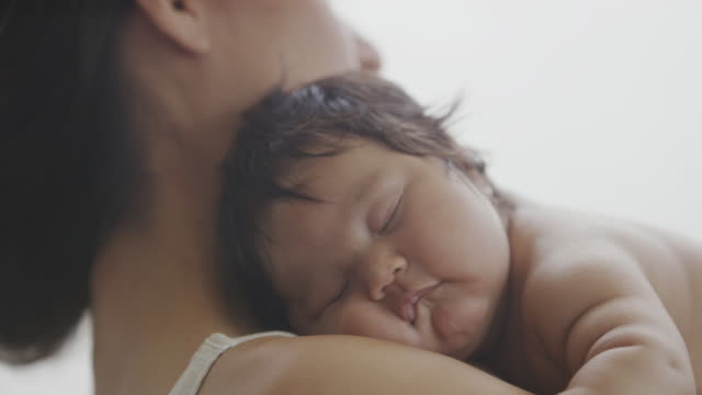 hispanic mother and baby bonding together - new stock videos & royalty-free footage