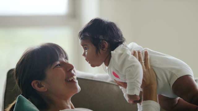 hispanic mother and baby - small stock videos & royalty-free footage
