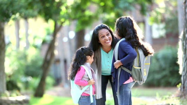 hispanic mother and daughters ready for school - 40 44 years stock videos & royalty-free footage