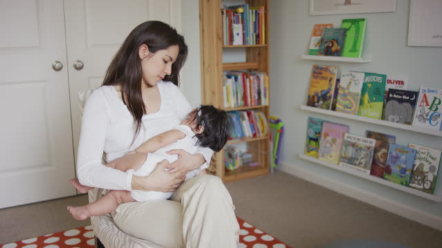 hispanic mother breast feeding - breastfeeding stock videos & royalty-free footage