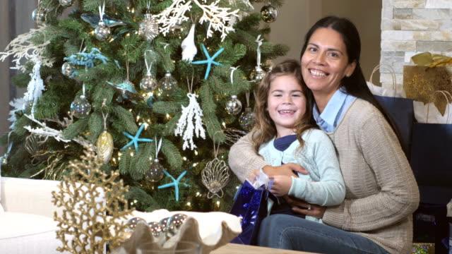 hispanic mother, mixed race daughter, florida christmas - tree hugging stock videos & royalty-free footage