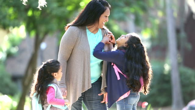hispanic mother with schoolgirls, older one talking - schoolgirl stock videos & royalty-free footage