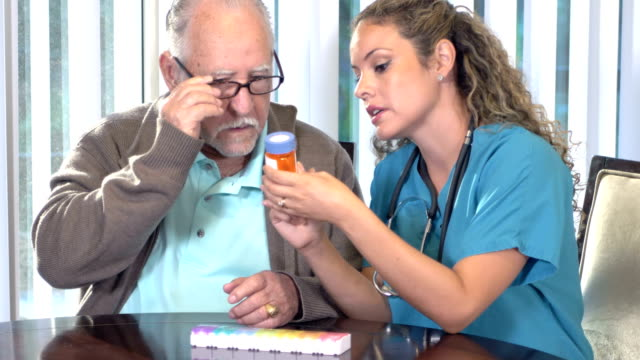 Hispanic nurse explaining medication to senior man