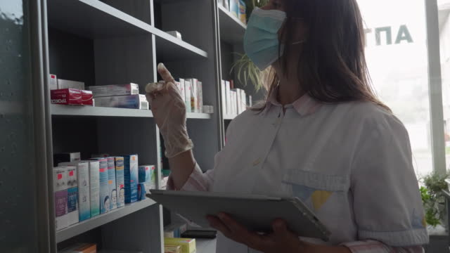 hispanic pharmacist's working day during covid-19 pandemic. using technology. - medical sales representative stock videos & royalty-free footage