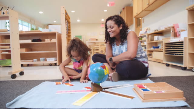 hispanic preschool student and teacher - child care stock videos & royalty-free footage