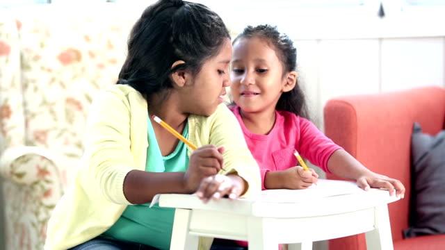 hispanic sisters doing their homework - 6 7 years stock videos & royalty-free footage