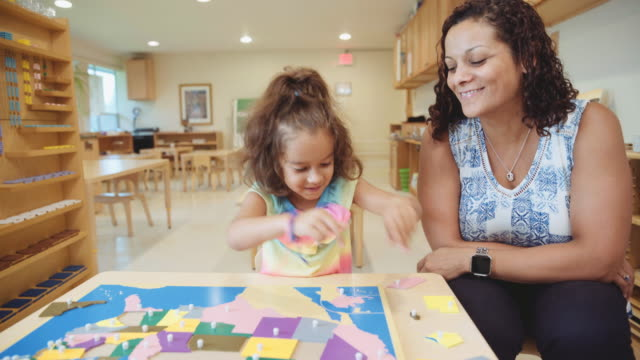 hispanic teacher and student - child care stock videos & royalty-free footage