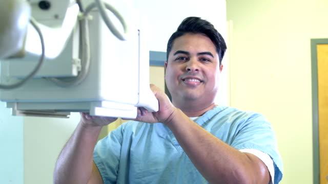 hispanic technologist using x-ray machine - radiographer stock videos & royalty-free footage