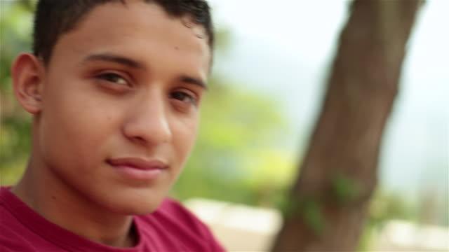 Hispanic teenager smiles at camera
