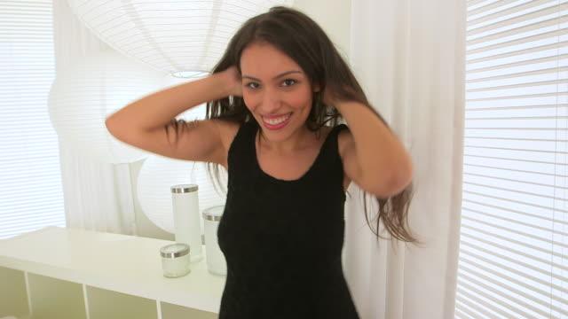 hispanic woman dancing in black dress in bed room - black dress stock videos & royalty-free footage
