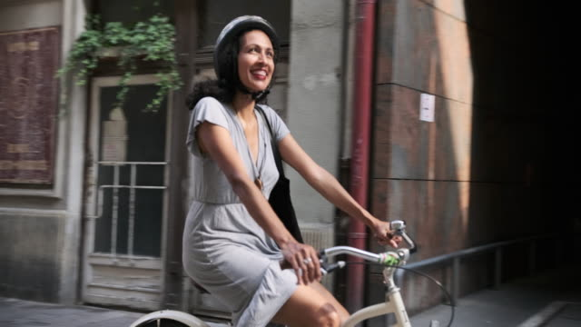 hispanic woman exploring budapest on bicycles with her two friends - sports helmet stock videos & royalty-free footage