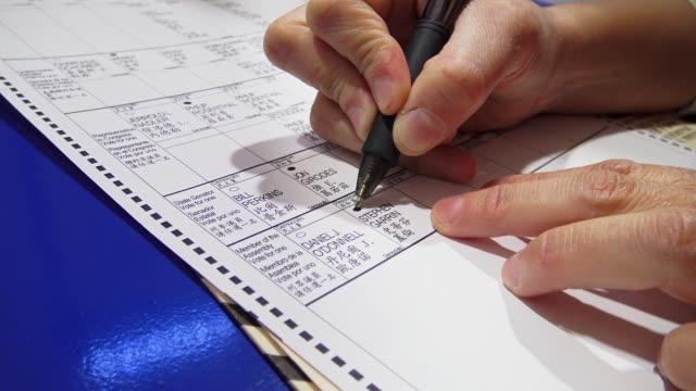 hispanic woman fills out a general election us presidential election ballot / upper west side, ps 163 west 96th street / manhattan, new york city,... - form filling stock videos & royalty-free footage