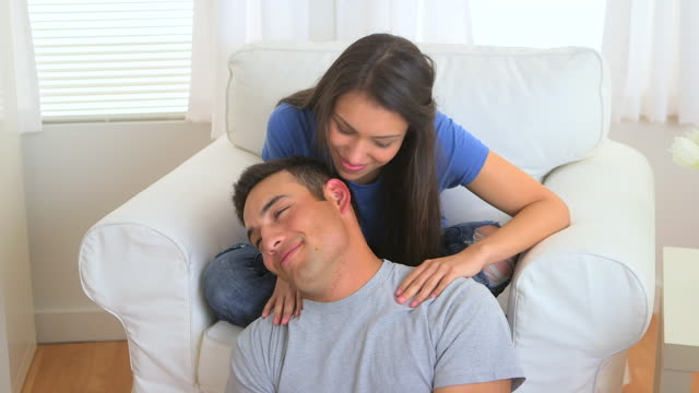 hispanic woman giving man a massage - 擦る点の映像素材/bロール