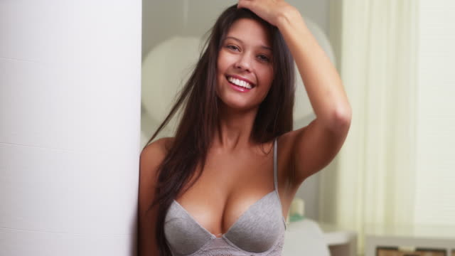 hispanic woman in lingerie smiling at camera - bra stock videos & royalty-free footage
