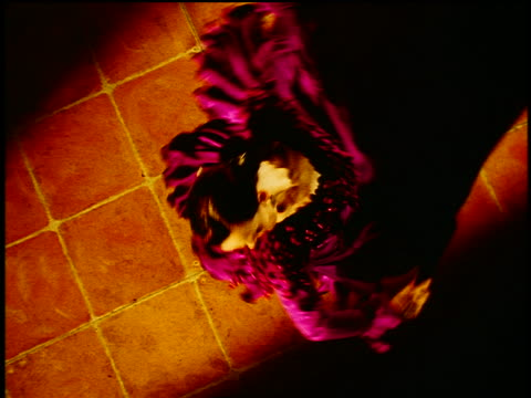 overhead hispanic woman in native dress with fan flamenco dancing + spinning on tile floor - flamenco dancing stock videos and b-roll footage