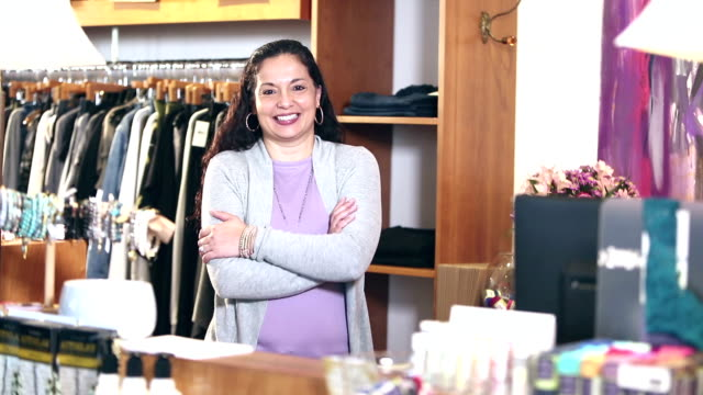 hispanic woman, owner of small business - arms crossed stock videos & royalty-free footage