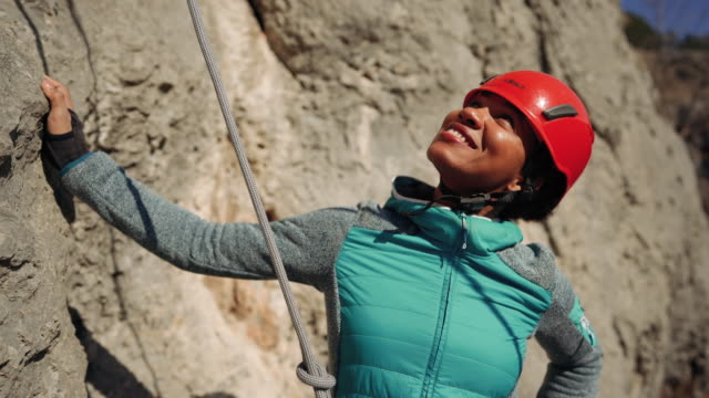 hispanic woman preparing for rock climbing - safety harness stock videos & royalty-free footage