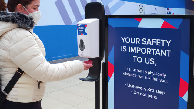 hispanic woman uses the hand sanitizer station inside of the fairview mall on november 2, 2020; in toronto, ontario, canada. it is part of the... - soap dispenser stock videos & royalty-free footage