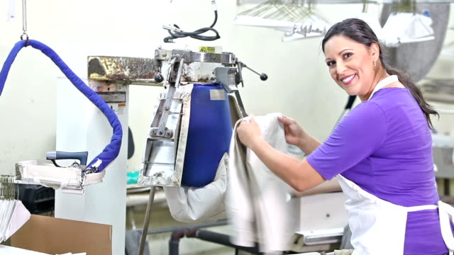 hispanic woman working in dry cleaners - minority groups stock videos and b-roll footage