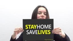 Hispanic young woman holding a sign stay home save lives. Pandemic 2019 Coronavirus 2019-nCoV.