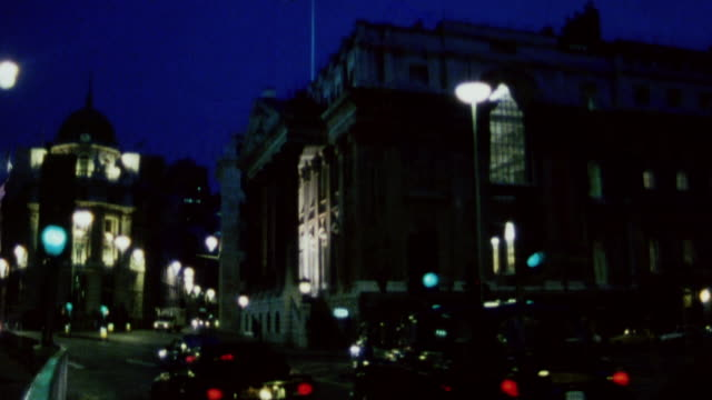 vídeos de stock e filmes b-roll de 1985 montage historic and unusual buildings in the city at night / city of london, england - 1985