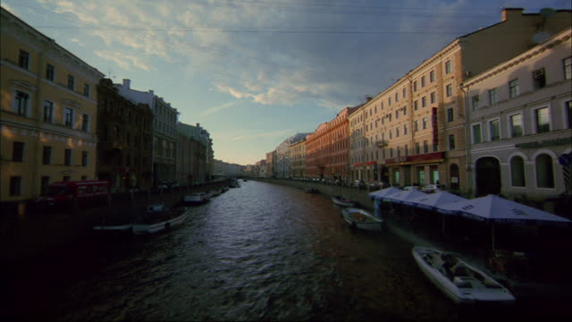 Historic buildings flank a canal in St. Petersburg.