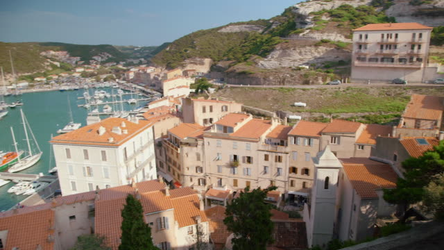 historic calvi port, corsica, wide pan left - calvi stock videos and b-roll footage
