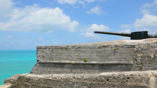historic cannon and wall in bermuda - cannon stock videos & royalty-free footage