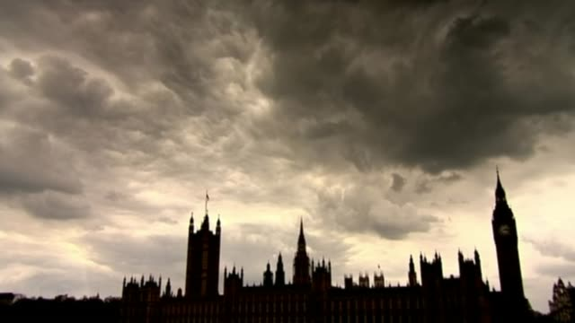 historic child sex abuse inquiry opens england london silhouette of houses of parliament and big ben clock tower under dark clouds / lady justice... - statue of justice london stock videos and b-roll footage